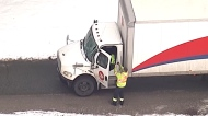 Falling ice injures driver