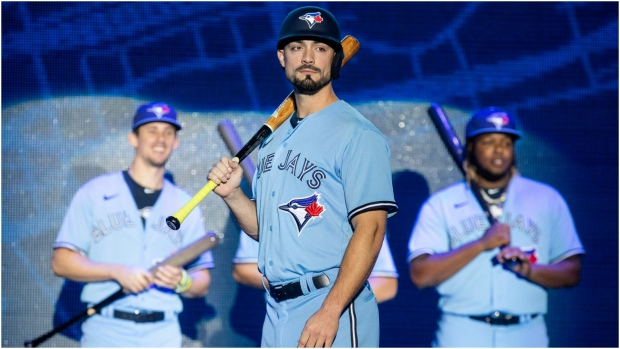 Toronto Blue Jays' Randal Grichuk stands to the fore as teammates Cavan Biggio (left) and Vladimir Guerrero Jr. look on as the team launch their new blue uniforms during their Winter Fest celebration in Toronto on Saturday January 18, 2020. Grichuk wants Major League Baseball to punish the 2017 Houston Astros as severely as possible, including taking away their World Series championship. THE CANADIAN PRESS/Chris Young