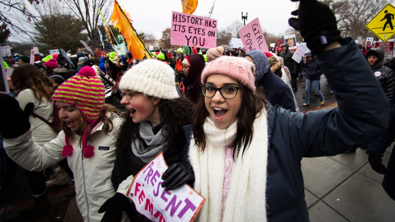 Georgetown students, from left, Emma Garman, Annmarie Rotatori and Claire Tebbutt, join the Women's March near the White House, Saturday, Jan. 18, 2020, in Washington. (AP Photo/Manuel Balce Ceneta)