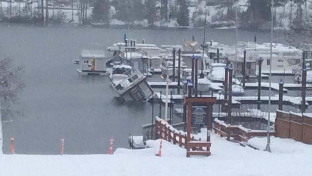 Float home sinking Cowichan lake
