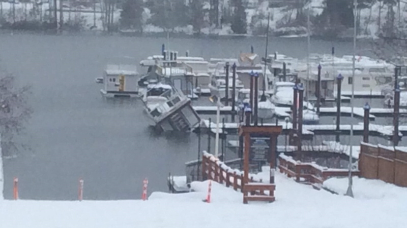 A houseboat docked at a marina on Cowichan Lake was sinking Saturday morning, after heavy snow fell overnight. (Bonnie Makowsky)