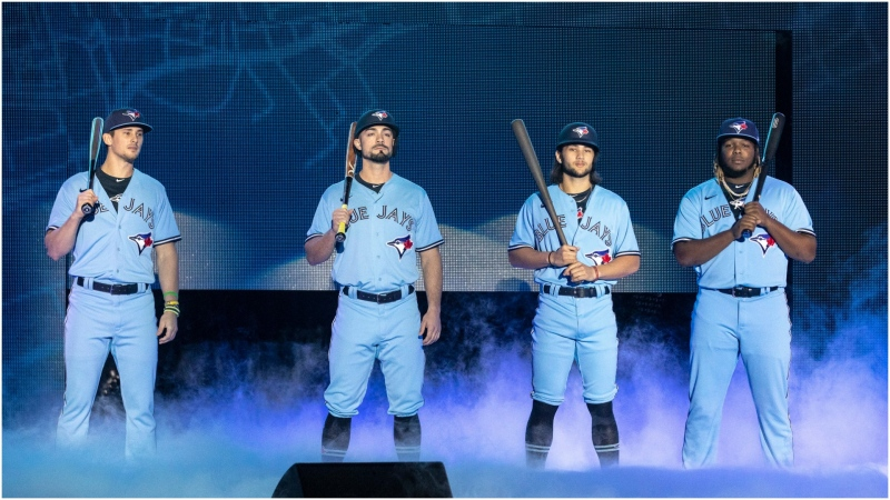 Toronto Blue Jays' Cavan Biggio, left to right, Randal Grichuk, Bo Bichette and Vladimir Guerrero Jr. unveil the team's new blue jersey during their Winter Fest celebration in Toronto on Saturday January 18, 2020. THE CANADIAN PRESS/Chris Young