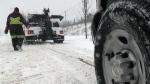 Tows kept busy as snow falls down