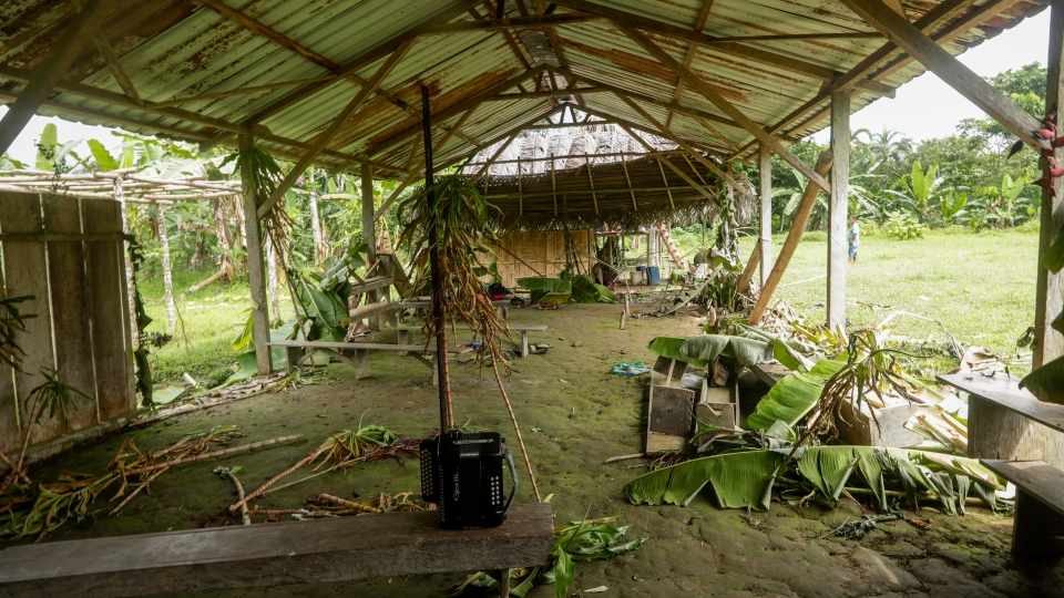 An accordion is on a bench inside the improvised temple where a pregnant woman, five of her children and a neighbor were killed by cult members in the remote hamlet of El Terron, Panama, Friday, Jan. 17, 2020. (AP Photo/Arnulfo Franco)