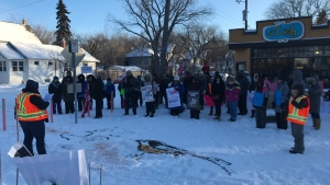 Dozens brave the cold for Saskatoon Women's March
