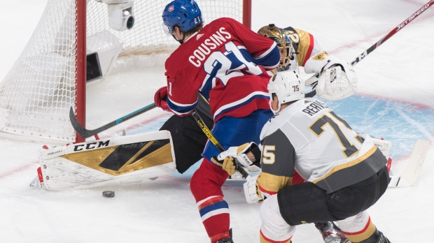 Montreal Canadiens' Nick Cousins (21) scores against Vegas Golden Knights goaltender Marc-Andre Fleury as Knights' Ryan Reaves defends during first period NHL hockey action in Montreal, Saturday, Jan. 18, 2020. THE CANADIAN PRESS/Graham Hughes