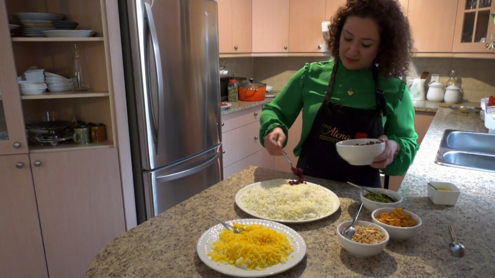 This woman is sharing a message of love and kindness through Persian food