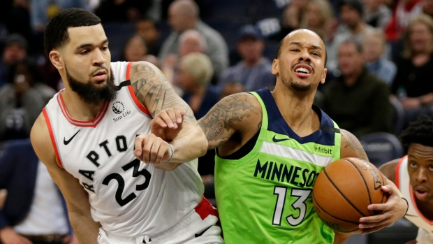 Minnesota Timberwolves guard Shabazz Napier (13) drives against Toronto Raptors guard Fred VanVleet (23) in the first quarter of an NBA basketball game Saturday, Jan. 18, 2020, in Minneapolis. (AP Photo/Andy Clayton-King)