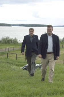 Harper follows Environment Minister John Baird up a hill prior to making an announcement regarding the expansion of Nahanni National Park, Wednesday, August 8, 2007. (CP PHOTO/ Fred Chartrand)