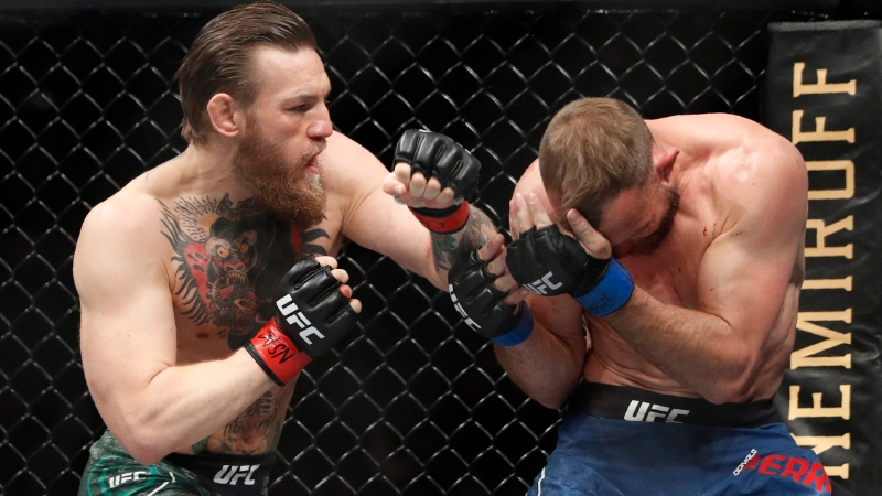 Conor McGregor, left, fights Donald 'Cowboy' Cerrone during a UFC 246 welterweight mixed martial arts bout Saturday, Jan. 18, 2020, in Las Vegas. (AP Photo/John Locher)