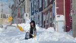 A resident digs a path from his house in St. John's on Saturday, January 18, 2020.  (THE CANADIAN PRESS/Andrew Vaughan)