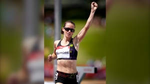 Malindi Elmore, from Kelowna, B.C., celebrates winning in the women's 1,500-metre event at the Canadian Track and Field Championships in Calgary, Alta., Friday, June 29, 2012. (THE CANADIAN PRESS / Jeff McIntosh)