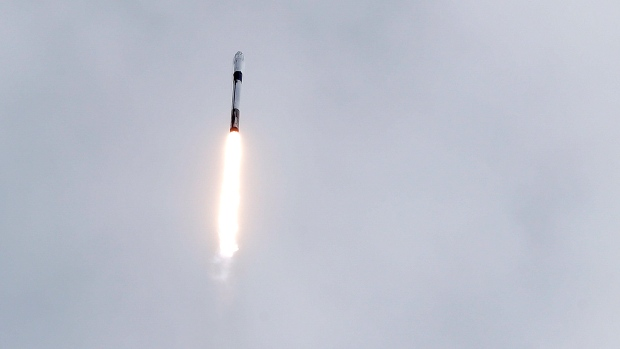 A Falcon 9 SpaceX rocket lifts off during a test flight to demonstrate the capsule's emergency escape system at the Kennedy Space Center in Cape Canaveral, Fla., Sunday, Jan. 19, 2020. (AP Photo/John Raoux)