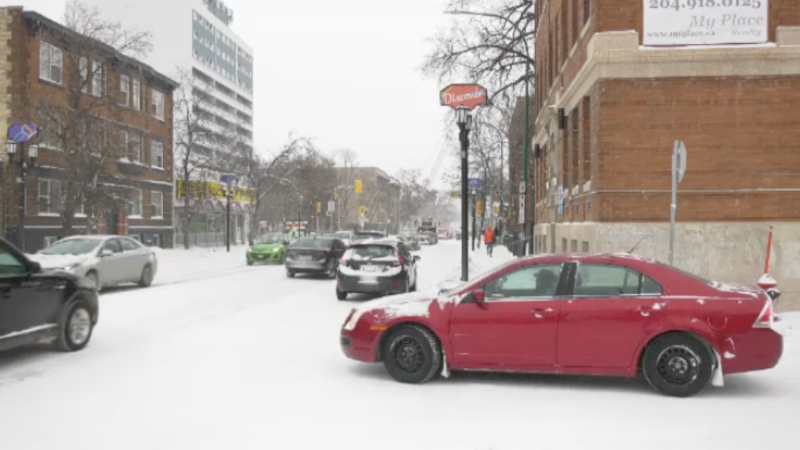 The city is focusing on clearing roads after upwards of 10 cm of snow fell Saturday.