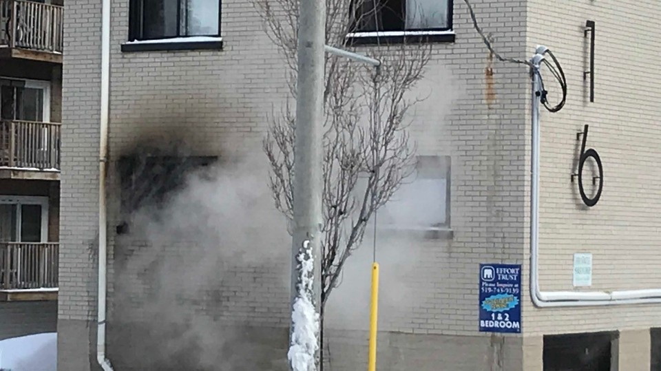 Smoke comes out a second-story window at an apartment building on Lancaster Street in Kitchener. (Johnny Mazza/CTV Kitchener) (Jan. 19, 2020)
