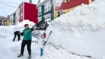 Residents dig out their car in St. John's on Sunday, Jan. 19, 2020. (THE CANADIAN PRESS/Andrew Vaughan)