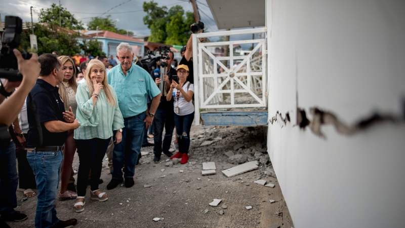 Governor Wanda Vazquez inspect an earthquake-damaged house in Guanica, Puerto Rico, Monday, Jan. 6, 2020. (AP Photo/Carlos Giusti)