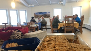 Residents at the Prairie Spruce Co-Housing development take in a communal meal. (Wayne Mantyka/CTV News)