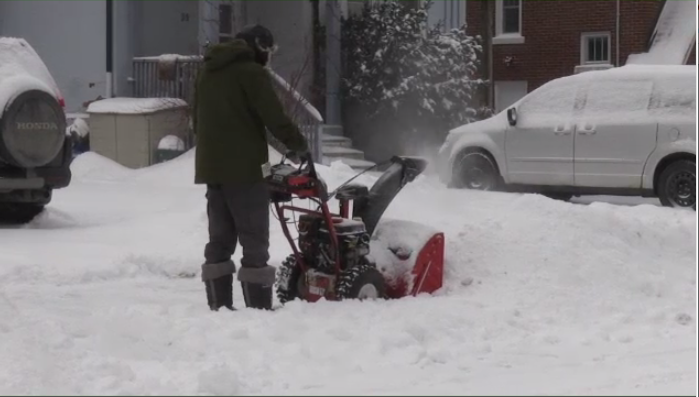 A Waterloo Region resident blows out snow following a large snowfall on Saturday. (Jan. 19, 2020)