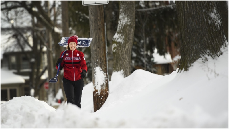 A woman walks back from helping her neighbours dig out from the heavy snow after Toronto and most of southern Ontario got hit by a storm in Toronto on Tuesday, January 29, 2019. THE CANADIAN PRESS/Nathan Denette
