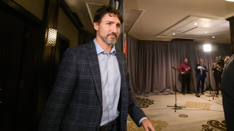 Prime Minister Justin Trudeau arrives to speak to media during the Liberal Cabinet Retreat at the Fairmont Hotel in Winnipeg, Sunday, Jan. 19, 2020. THE CANADIAN PRESS/Mike Sudoma