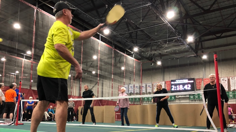 Saskatoon residents try out pickleball at an open house meant to grow the game. (Chad Leroux/CTV News)