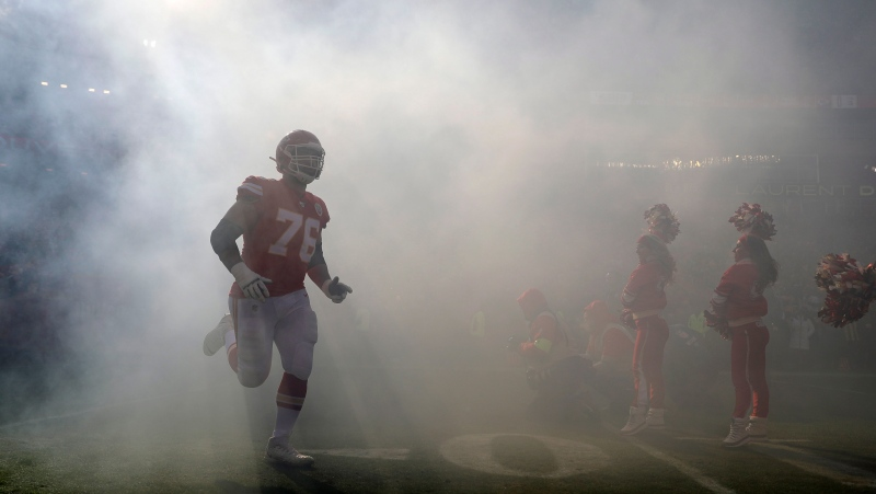 Kansas City Chiefs' Laurent Duvernay-Tardif (76) is introduced before the NFL AFC Championship football game against the Tennessee Titans on Sunday, Jan. 19, 2020, in Kansas City, MO. (AP Photo/Jeff Roberson)