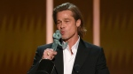 "Brad Pitt kisses ""The Actor"" statuette as he accepts the award for outstanding performance by a male actor in a supporting role for ""Once Upon a Time in Hollywood"" at the 26th annual Screen Actors Guild Awards at the Shrine Auditorium & Expo Hall on Sunday, Jan. 19, 2020, in Los Angeles. (Photo/Chris Pizzello)"
