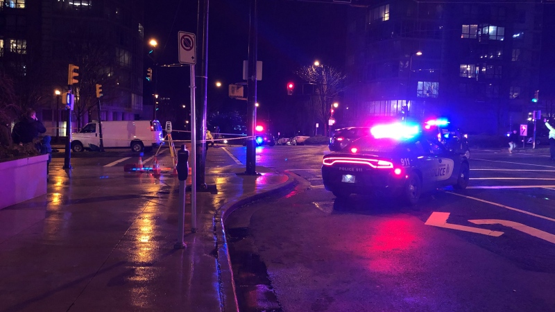Two people were taken to hospital - one in critical condition - after being hit by a vehicle near the intersection of Richards and Pacific streets Sunday evening. (Allison Hurst/CTV)