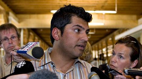 MP Rahim Jaffer, the national caucus chairman reacts to the eviction of journalists by plain-clothes RCMP officers from the lobby of the Charlottetown hotel where the federal Conservative caucus is holding its annual meeting Wednesday, Aug. 1, 2007, in Charlottetown P.E.I. (CP PHOTO/Jacques Boissinot)