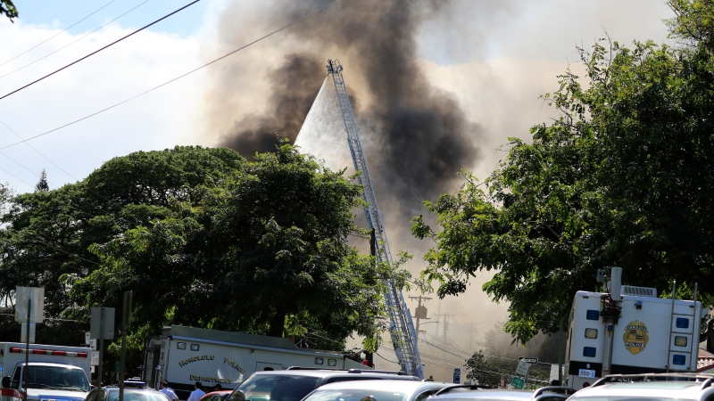 Several house fires burn in a Diamond Head neighborhood Sunday, Jan. 19, 2020, in Honolulu, following a shooting in which two police officers were shot. (AP Photo/Marco Garcia)