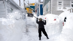 A resident clears snow in St. John's on Sunday, Jan. 19, 2020. The state of emergency ordered by the City of St. John's continues, leaving most businesses closed and vehicles off the roads in the aftermath of the major winter storm that hit the Newfoundland and Labrador capital. THE CANADIAN PRESS/Andrew Vaughan