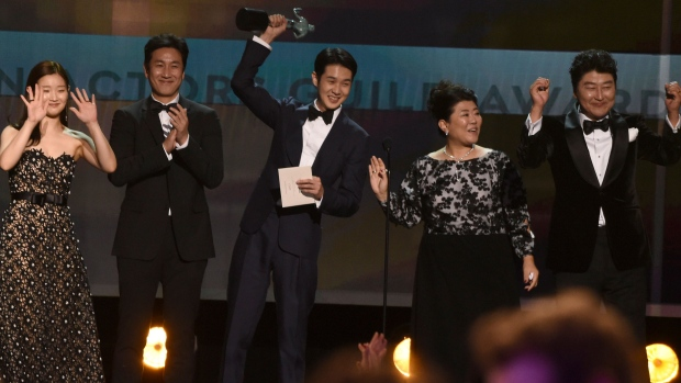 Park So-dam, from left, Lee Sun Gyun, Choi Woo-shik, Lee Jeong-eun and Kang-Ho Song accept the award for outstanding performance by a cast in a motion picture for 'Parasite' at the 26th annual Screen Actors Guild Awards at the Shrine Auditorium & Expo Hall on Sunday, Jan. 19, 2020, in Los Angeles. (AP Photo/Chris Pizzello)