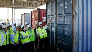 Malaysia's Environment Minister Yeo Bee Yin, third from left, inspects a container with plastic waste at a port in Butterworth, Malaysia, Monday, Jan. 20, 2020. (AP Photo/Vincent Thian)