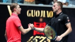 Hungary's Marton Fucsovics, right, is congratulated by Canada's Denis Shapovalov after winning their first round singles match at the Australian Open tennis championship in Melbourne, Australia, Monday, Jan. 20, 2020. (AP Photo/Dita Alangkara)