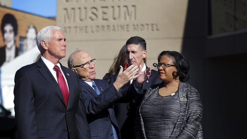 U.S. Vice President Mike Pence, left, listens to the history of the Civil Rights Museum during a visit, Sunday, Jan. 19, 2020, to Memphis, Tenn., on the eve of Dr. Martin Luther King Jr. Day. (Patrick Lantrip/Daily Memphian via AP)