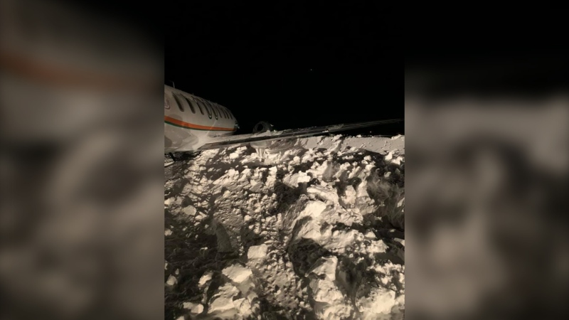 The plane veered off the runway and crashed into a snowbank. (Source: Facebook/Eric Redhead)