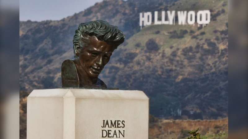 "This Friday, Jan. 17, 2020, photo shows a bust of actor James Dean at the Griffith Observatory in the Griffith Park area of Los Angeles. Travis Cloyd, who is leading the revival of Dean for his appearance in ""Finding Jack,"" says his company will eventually offer the late actor's digital likeness for a range of roles in movies, TV and video games. (AP Photo/Richard Vogel)"