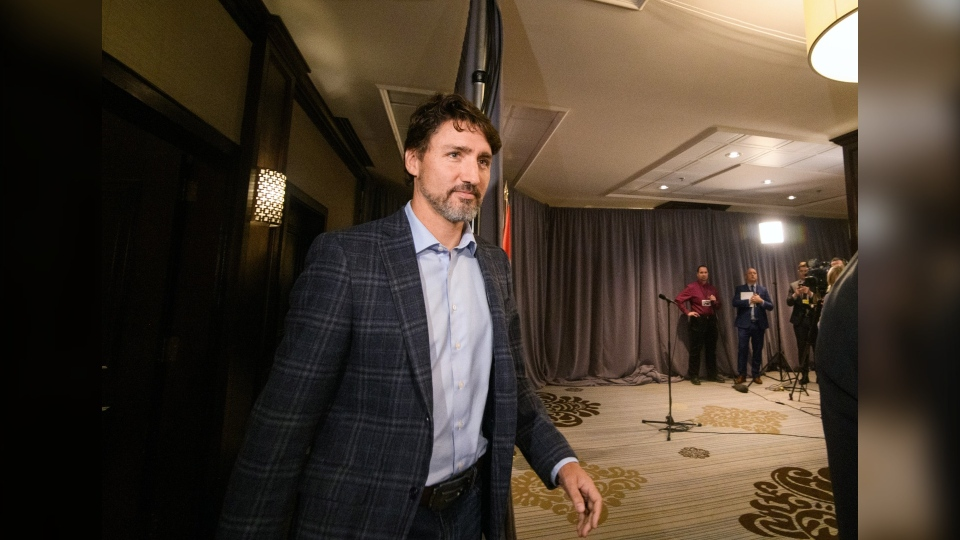 Prime Minister Justin Trudeau arrives to speak to media during the Liberal Cabinet Retreat at the Fairmont Hotel in Winnipeg, Sunday, Jan. 19, 2020. (THE CANADIAN PRESS/Mike Sudoma)
