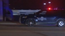 In this image made from video, a police vehicle passes with sirens near the scene of a shooting in Kansas City, Missouri, on Jan. 20, 2020. (KMBC via AP)