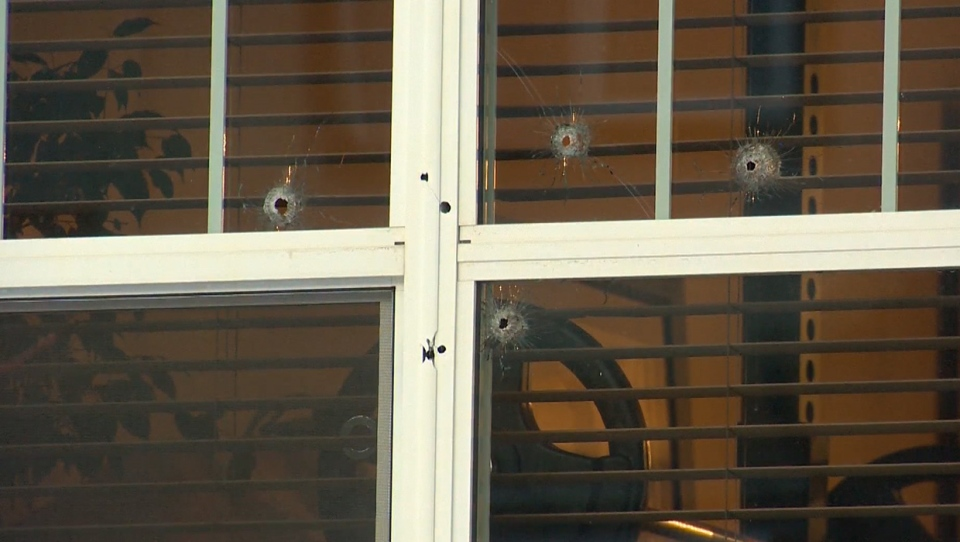 Bullet holes in the window of a home in the southeast neighbourhood of Auburn Bay following a shooting on Jan. 6, 2020