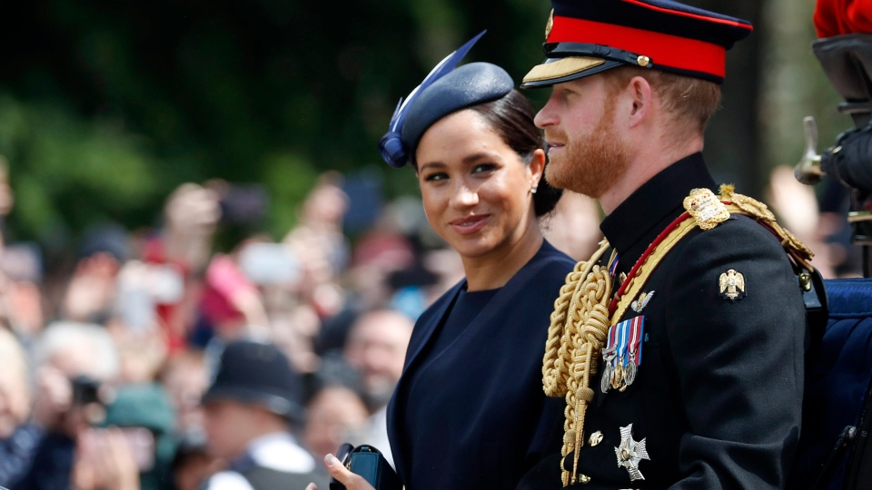 In this Saturday, June 8, 2019 file photo, Meghan, the Duchess of Sussex and Prince Harry ride in a carriage to attend the annual Trooping the Colour Ceremony in London. (AP Photo/Frank Augstein, file)