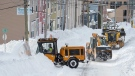 Workers clear the streets in St. John's on Sunday, Jan. 19, 2020. THE CANADIAN PRESS/Andrew Vaughan
