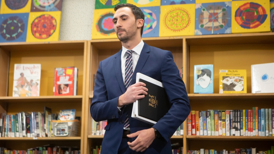 Ontario Education Minister Stephen Lecce stands in the library at Ogden Junior Public School after making an announcement, in Toronto, Wednesday, Nov. 27, 2019. THE CANADIAN PRESS/Chris Young