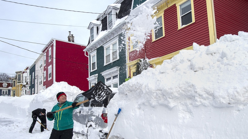 Residents dig out their car in St. John's, N.L., on Jan. 19, 2020.  (Andrew Vaughan / THE CANADIAN PRESS)