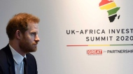 Britain's Prince Harry meets with Prime Minister of Morocco Saadeddine Othmani at the UK Africa Investment Summit in London, Monday Jan. 20, 2020. Britain's Prime Minister Boris Johnson is hosting 54 African heads of state or government in London, as the U.K. prepares for post-Brexit dealings with the world. (Stefan Rousseau/Pool via AP)