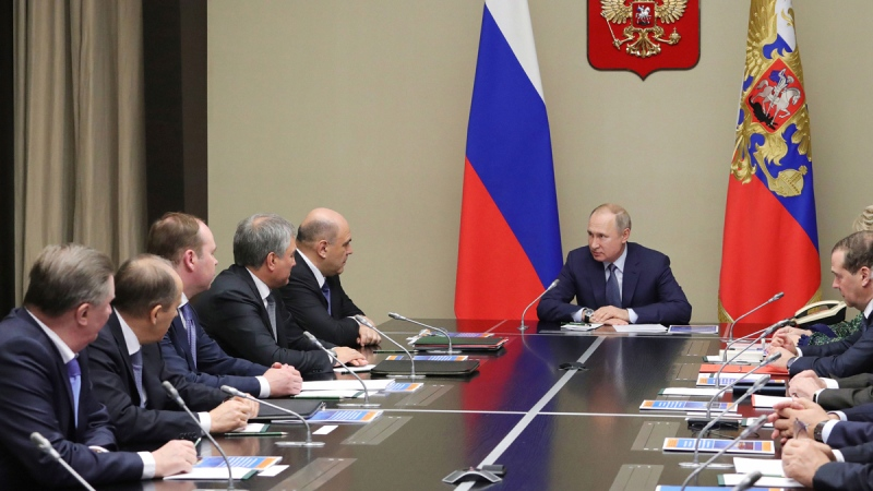 Russian President Vladimir Putin, centre, chairs a Security Council meeting, on Jan. 20, 2020. (Mikhail Klimentyev, Sputnik, Kremlin Pool Photo via AP)