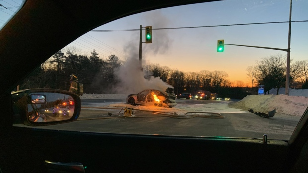 Car fire at busy intersection in Midland January 20, 2020 (Photo: Const. M. Tuck, OPP)
