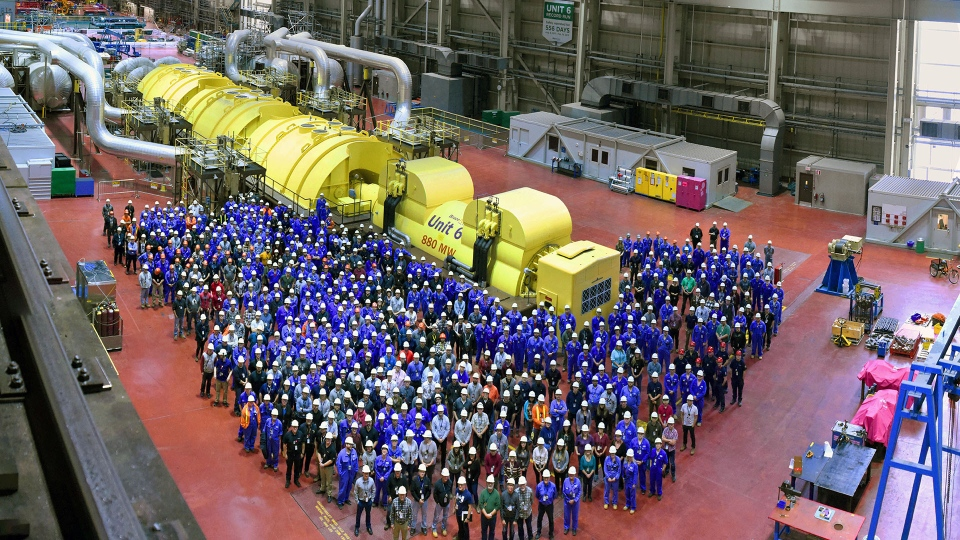 Workers at Bruce Power's Unit 6 gather