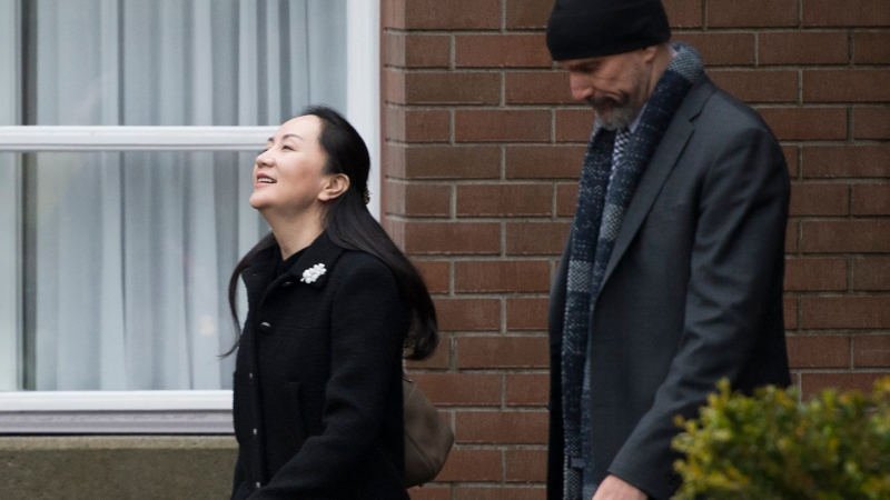 Meng Wanzhou, chief financial officer of Huawei leaves her home in Vancouver, Monday, January, 20, 2020. A court hearing begins today in Vancouver over the American request to extradite an executive of the Chinese telecom giant Huawei on fraud charges. (THE CANADIAN PRESS/Jonathan Hayward)